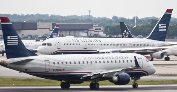 US Airways anuncia proceso de fusión con American Airlines, en bancarrota