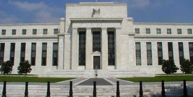 Fed pone fin a estímulo monetario y mantiene tasas cerca de cero
