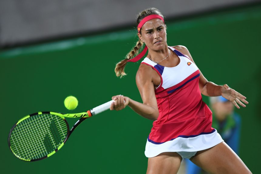 Puerto Rico's Monica Puig returns the ball to Germany's Angelique Kerber during their women's singles finals tennis match at the Olympic Tennis Centre of the Rio 2016 Olympic Games in Rio de Janeiro on August 13, 2016. / AFP / Martin BERNETTI        (Photo credit should read MARTIN BERNETTI/AFP/Getty Images)